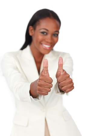 Happy businesswoman with thumbs up  photo
