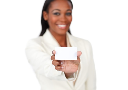Smiling afro-american businesswoman holding a white card Stock Photo - 10095123