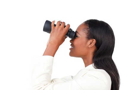 Portrait of a smiling businesswoman using binoculars Stock Photo - 10095247