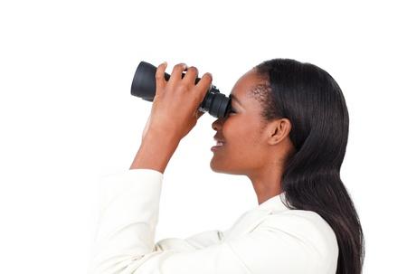 Portrait of a smiling businesswoman using binoculars Stock Photo - 10095247