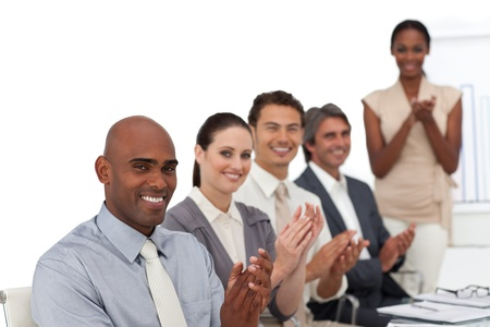 Multi-ethnic business people applauding after a presentation photo