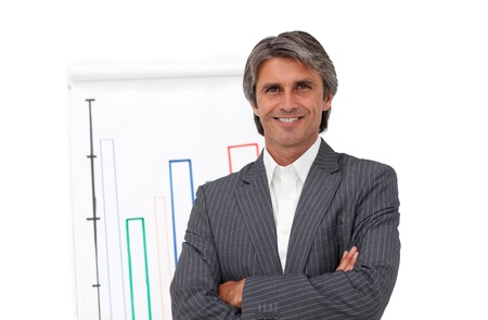 Smiling mature businessman in front of a board photo