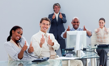 teaming up: Portrait of a successful business team at work