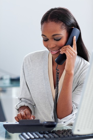 Assertive ethnic businesswoman talking on a phone  Stock Photo - 10097402