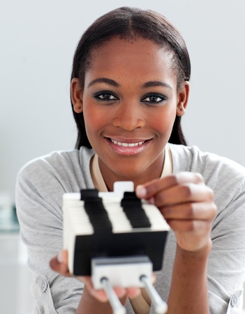 Charming ethnic businesswoman holding a business card holder  photo