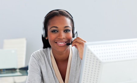 Afro-american customer service representative with headset on Stock Photo - 10096960