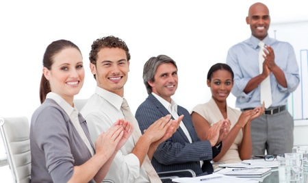 Assertive business people clapping a good presentation  photo