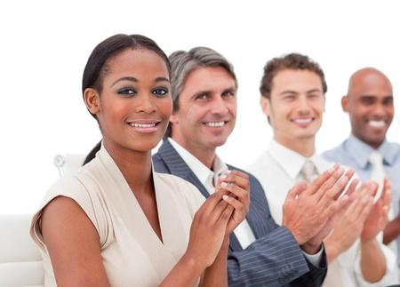 International business people applauding a presentation Stock Photo - 10095437