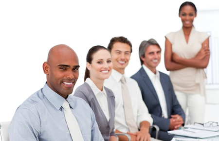 Self-assured multi-ethnic business group at a presentation  Stock Photo - 10096637