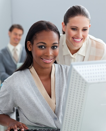 Portrait of two businesswomen working at a computer photo