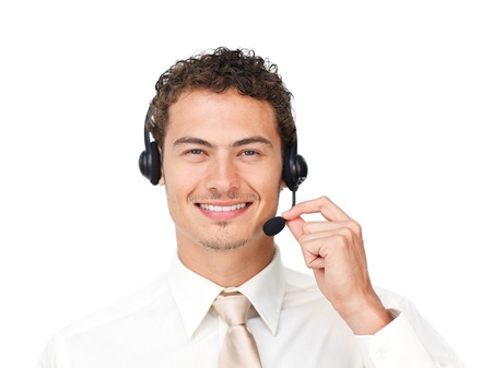 Charismatic latin businessman using headset Stock Photo - 10095093
