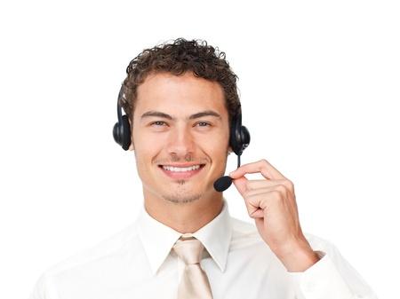 Charismatic latin businessman using headset Stock Photo - 10095093