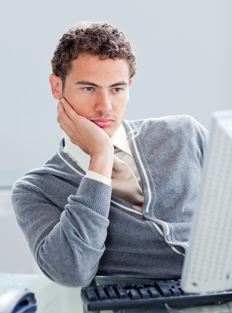 businesswear: Bored businessman at his desk