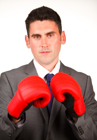 Serious businessman with boxing gloves Stock Photo - 10097392