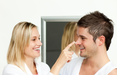 Couple having fun with cream in bathroom Stock Photo - 10097072