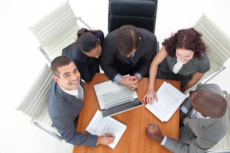 High angle of smiling businessman working with her team Stock Photo - 10097485