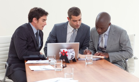 Businessmen in a meeting  working together Stock Photo - 10096617