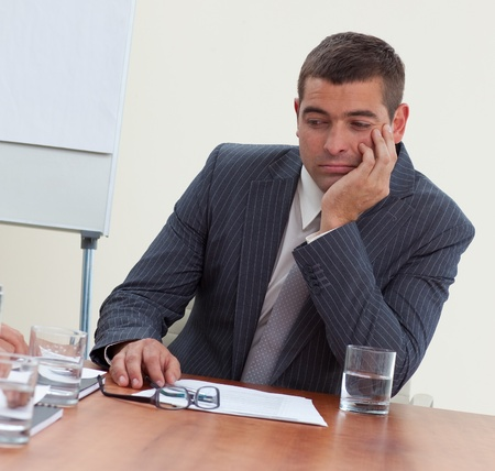 Attractive businessman bored in a meeting photo