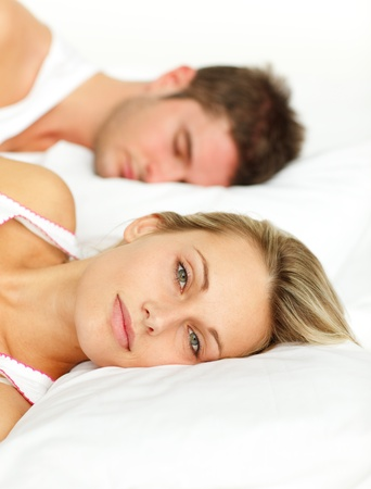 Portrait of a young couple sleeping on their bed  photo