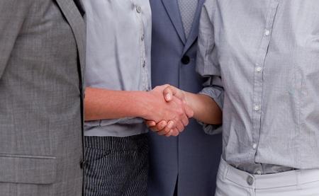 stipulation: Close-up of a fortunate businessteam closing a deal