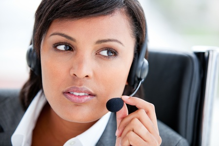 Portrait of a beautiful customer service agent at work photo
