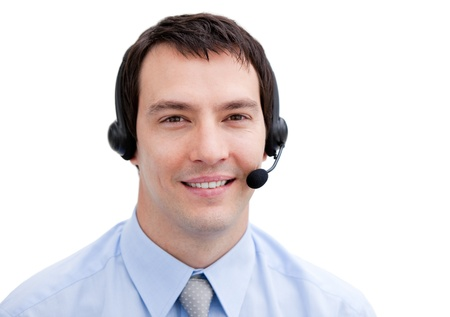 Portrait of a smiling businessman with headset on  photo