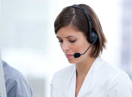 Portrait of a brunette customer agent at work photo
