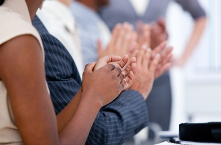 kudos: Ambitious business team applauding in a meeting