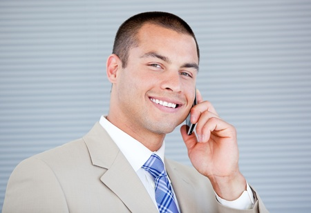 assertive: Assertive businessman talking on phone