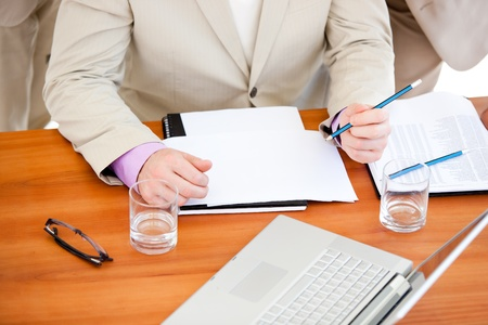Close-up of a businessman working in a meeting photo