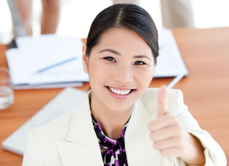 fortunate: Confident businesswoman with thumbs up