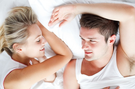 Couple lying in bed photo