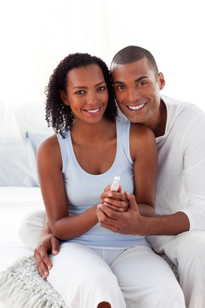 finding out: Smiling Afro-american couple finding out results of a pregnancy test