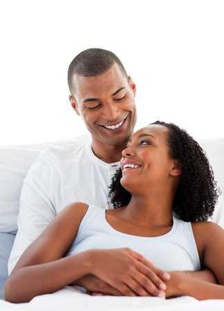 flattery: Enamoured couple cuddling lying on their bed