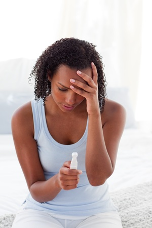 Upset woman finding out results of a pregnancy test  photo