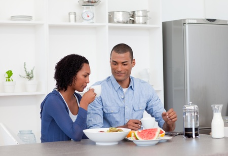 Smiling couple having breakfast together photo