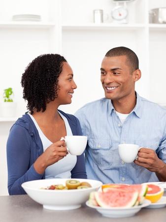 Smiling lovers having healthy breakfast photo