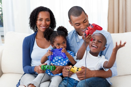 Happy Afro-american family playing video games photo