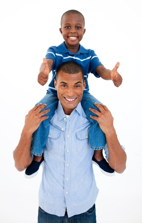 piggyback: Father giving son piggyback ride with thumbs up  Stock Photo