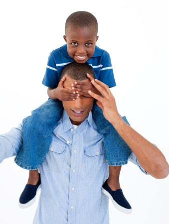 Close-up of a father giving son piggyback ride with closed eyes  photo