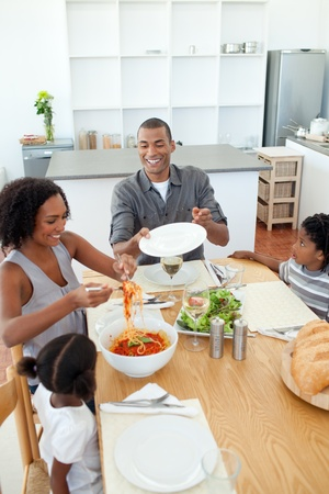 Afro-american family dining together photo