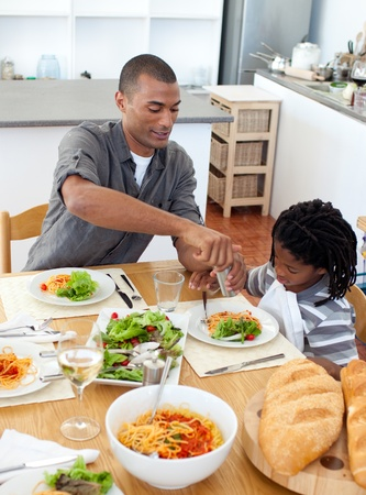 Ethnic little boy dining with his father Stock Photo - 10095977