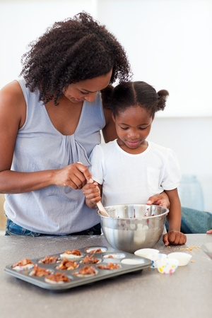 baking cookies: Adorable little girl preparing biscuits with her mother  Stock Photo