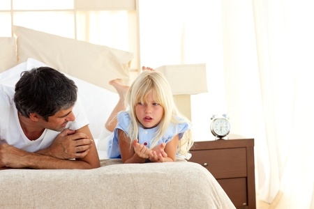 unhappy family: Attentive father talking with his daughter