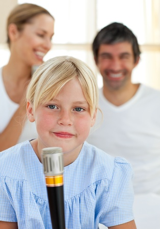 child singing: Blond child singing with a microphone
