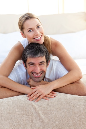 Enamoured couple lying on the bed photo