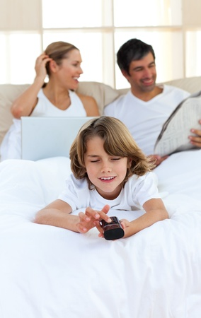 Adorable son watching TV photo
