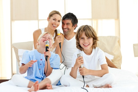 Happy family singing together  photo