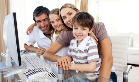 Portrait of a smiling family at a computer Stock Photo - 10097375