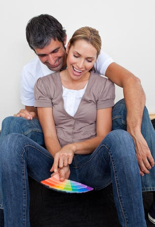 Loving lovers decorating their new house Stock Photo - 10097037